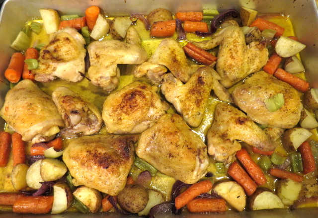 A baking sheet of roasted chicken and vegetables